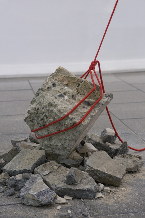 Installation detail: Metacrush [Aggregate rock belaying photograph (out of shot), rope in figure of 8 climber's knot, rubble]. Show: The Present Hurts. London College of Communication 2015