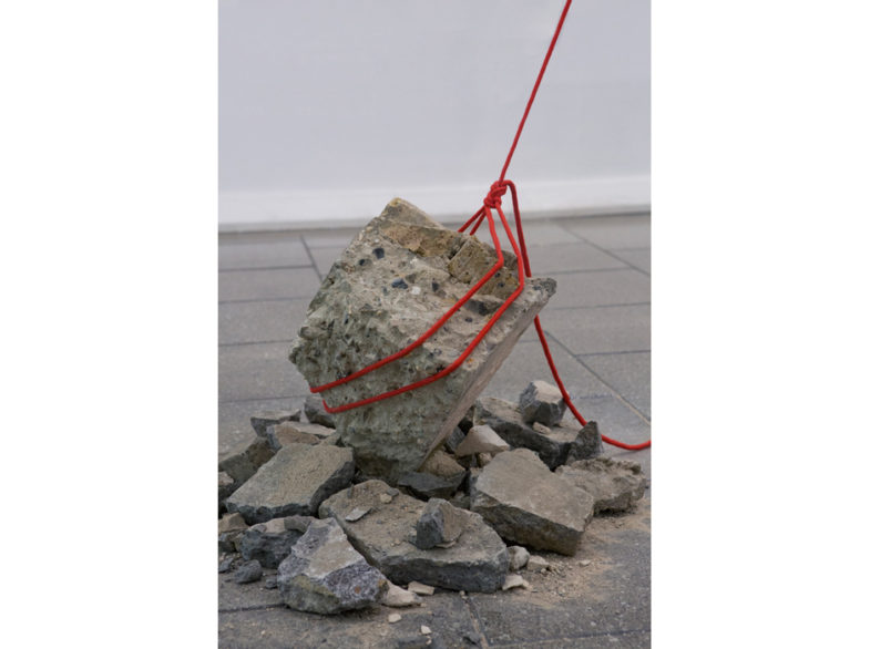 Detail from Metacrush [aggregate rock belaying photograph (out of shot), rope in figure of 8 climber's knot, rubble], 2015