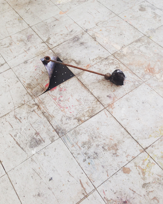 Mineral pushing found metal rusted object lifting floor tile. From installation: Where space is granular, time does not exist and things are nowhere. Lifeboat Studio Residency, London 2016
